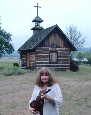 Sharyn McCrumb with Tom Dula's fiddle